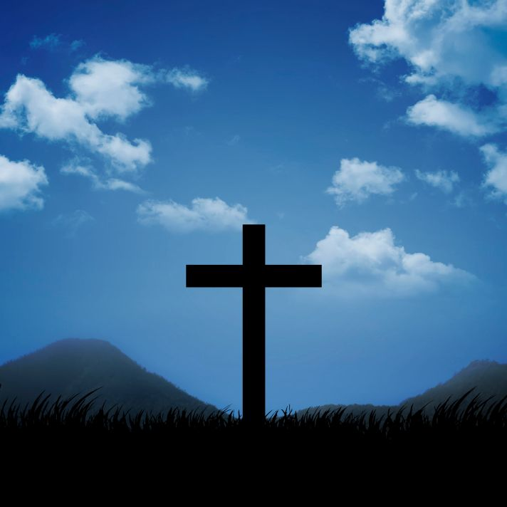 Christian cross with blue sky and cloud background