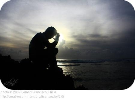 Man Praying Near Water