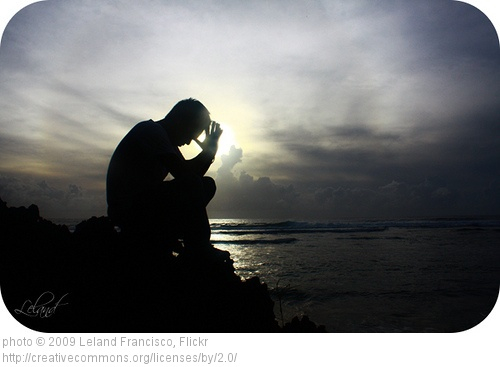 Man Praying Near Water